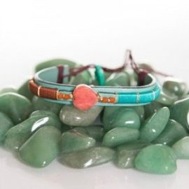 heavy woven turquoise bracelet with beautiful red stone heart and beads